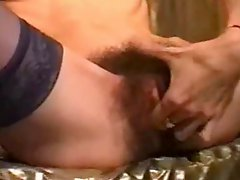 Dildoing and fingering a very hairy french pussy