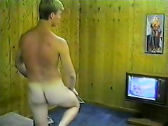 Sexy blonde dude whacks his hard meat while watching some porn