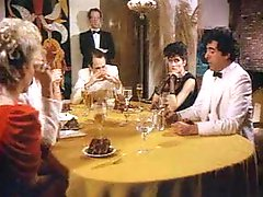 Retro porn dinner party and group fuck scene