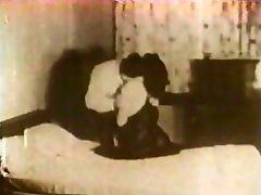 Sepia-colored double feature clip of an orgy and a couple copulating