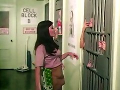 Lesbian action with galore of retro bitches in the prison