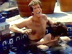 A couple fucks around in the pool in vintage porn