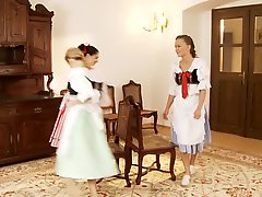 Three playfil babes in vintage dresses pleasure each other