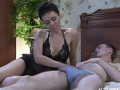 Delightful brunette milf Viola seduces the young Austin to satisfy her sexual needs