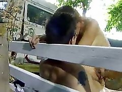 Lusty couple furious sex on the bench in the park.