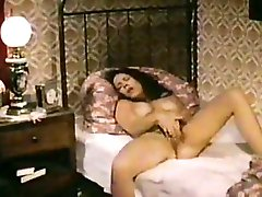 Sexy busty brunette woman masturbates and fucks