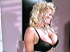 Busty blonde slut Sally Layd sucks a dildo and a cock in this vintage action
