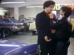Raunchy brunette gal gives blowjob to car dealer at his workplace