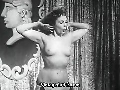 Busty Babe Shakes Her Tits Onstage