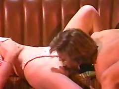 Vintage lesbian sex scene between a short-haired girl and a curly-haired woman