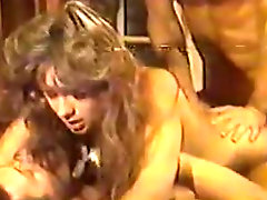 Sheri St. Claire gives blowjob to  John Holmes and Jon Martin in vintage sex scene