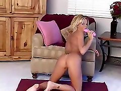 Blonde big breasted diva toying her fanny with pink dildo