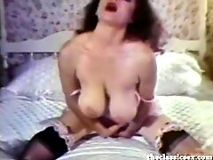 Busty retro babe masturbates in bed