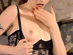 Alluring brunette strips off her clothes and takes a big rod up her ass