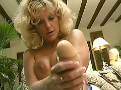 Lecherous classic milf fucks her stretched pussy with plastic hand