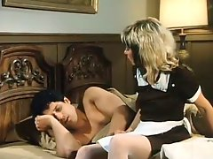 Vulgar brunette hotel maid gives blowjob to the client in room