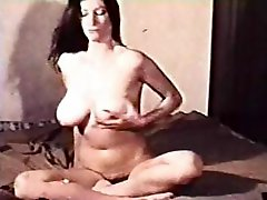 Yummy brunette MILF with big boobs and a hairy pussy gives us a great show