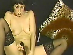 Vintage brunette moans with pleasure while playing with two dildos