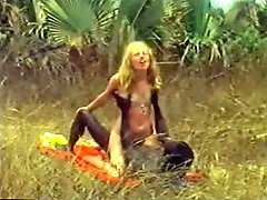Blonde hottie takes a ride on a BBC outdoors. Hot vintage clip