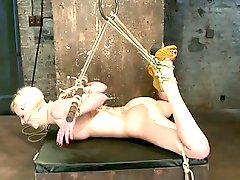 Cherry is bound in a classic hogtie, leaving her pussy exposed to...