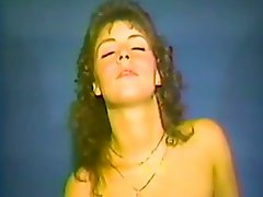 Lovely brownie toys her ass and pussy in retro video