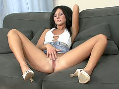 Black haired babe in skirt Dora masturbating