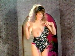 Retro 80s babe in a sexy striptease