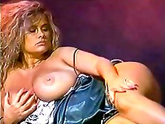 Trinity Loren is a blonde vintage porn babe who plays with her tits