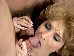 Voracious blonde hooker in lingerie enjoys hardcore DP - retro