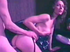 Sexy retro scene with a busty brunette beauty