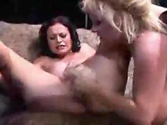 Two big titty milf chicks using a toy