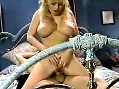 The tease video ends with cum on her retro tits