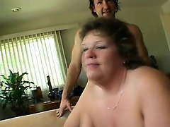 Mature fattie in stockings moans as a younger man plows her cooch