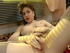 From the early 90s: french cutie plays with red dildo