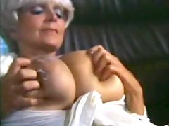 Retro porn milf likes to show her big tits