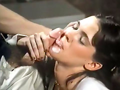 Cock sucking adventures of two beautiful brunettes in retro porn video