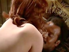 Redhead white woman with black man - 1970s Interracial Softcore
