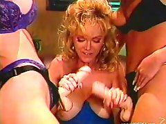 Seductive porn star cougars with big tit ravishing each other with strap on in a retro action