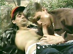 Horny gay blowjob in a classic porn video