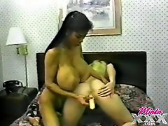 Lesbians with massive breasts share a dildo