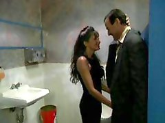 Vintage video of a trashy whore fucking a dude in a bathroom
