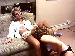Retro lesbian fun with lingerie babes eating box