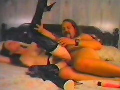 Mature brunette masturbates before riding a big cock in vintage clip