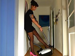Cleaning the house in one pink heel and stockings