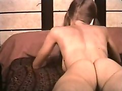 Sweet looking brunette strokes her hairy pussy and masturbates