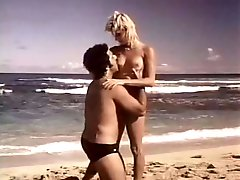 Ron Jeremy gets laid with beautiful shapely blondie on the beach