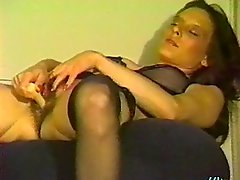 Attractive cowgirl in nylon stocking masturbating using vibrator while moaning