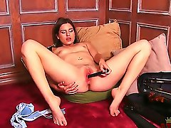 Hot brunette Christie Nelson plays a classical tune on the viola and masturbates