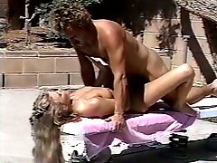Horny man fucks hairy kitty of his sexy blond bitch in pool area